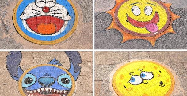 井盖创意涂鸦点亮城市生活